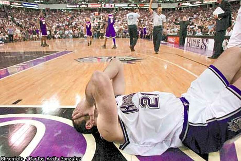 Kings's Vlade Divac, lays on the floor as he fouls out in the final minutes of regulation. The Kings lost to the Los Angeles Lakers in the final seconds of overtime at ARCO Arena in Sacramento, Ca. The Sacramento Kings played the Los Angeles Lakers in Game 7 of the NBA Western Conference Finals at Arco Arena in Sacramento, Ca., on Tuesday, May 28, 2002.  (PHOTO BY CARLOS AVILA GONZALEZ/THE SAN FRANCISCO CHRONICLE) Photo: CARLOS AVILA GONZALEZ