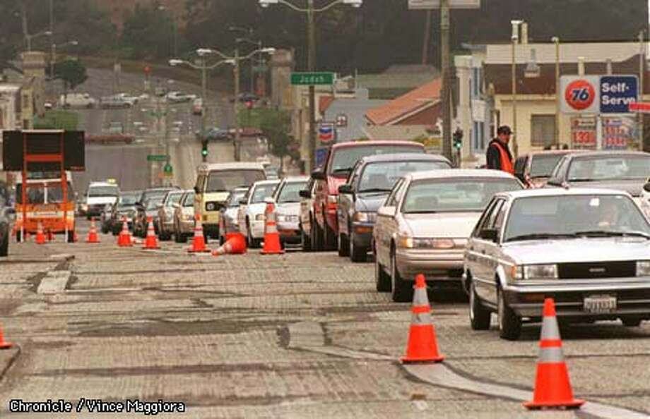 = Trafic jam southbound on 19th ave ,workers are grinding up the old road and pave it at night. by Vince Maggiora Photo: VINCE MAGGIORA