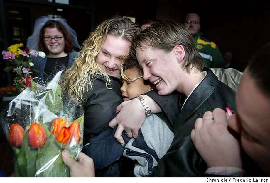 ; Candice Wicklinder (right) and Tracie Jones (with her son Jordan Jones) where one of the first gay couples to recieve a marriage license. Gay and lesbian couples started tying the knot in Portland on Wednesday after the county issued same-sex marriage licenses, joining the rapidly spreading national movement from San Francisco to upstate New York. Hundreds of people lined up for a sudden chance to wed after a Multnomah County commissioner where they began to issue marriage licenses to same-sex couples. Many couple got married in front of the building just minutes after receiving their license. City:� 3/3/04, in Portland, OR. Frederic Larson/The Chronicle; Photo: Frederic Larson