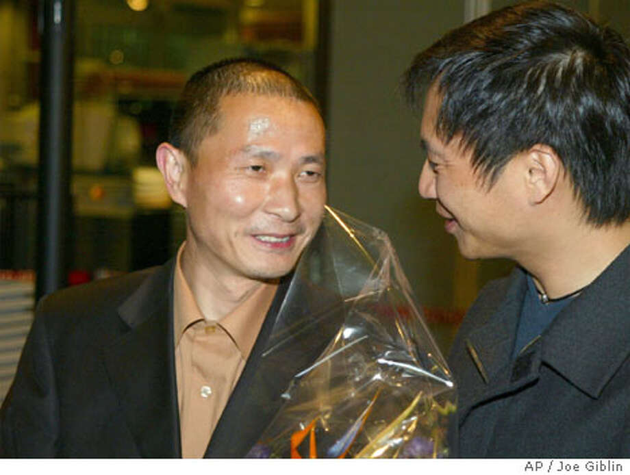 Chinese dissident Wang Youcai, left, is greeted by fellow Tienamen Square protester Wang Dan upon his arrival at T.F. Green Airport in Warwick, R.I., on Thursday, March 4, 2004. Wang Youcai, a co-founder of the Chinese Democratic Party and a student leader of the Tienamen Square Democracy protest was released from a Chinese prison yesterday. Youcai, 37, a physicist, was given medical parole and left the Zhejiang No. 1 prison early in the day, said John Kamm, executive director of the Dui Hua Foundation, a rights group. (AP Photo/Joe Giblin) Photo: JOE GIBLIN