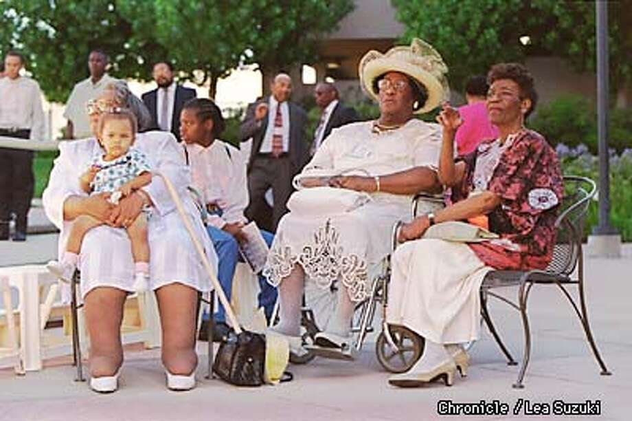 FROM LEFT: Lenore B. Fields who is holding grandaughter, Brittany Nicole Fields, 1, on her lap, Mabel Hurdle, and Edna Hurdle Fuller wait in the courtyard at the Embassy Suites in Walnut Creek before the family portrait is taken. Photo By Lea Suzuki Photo: LEA SUZUKI