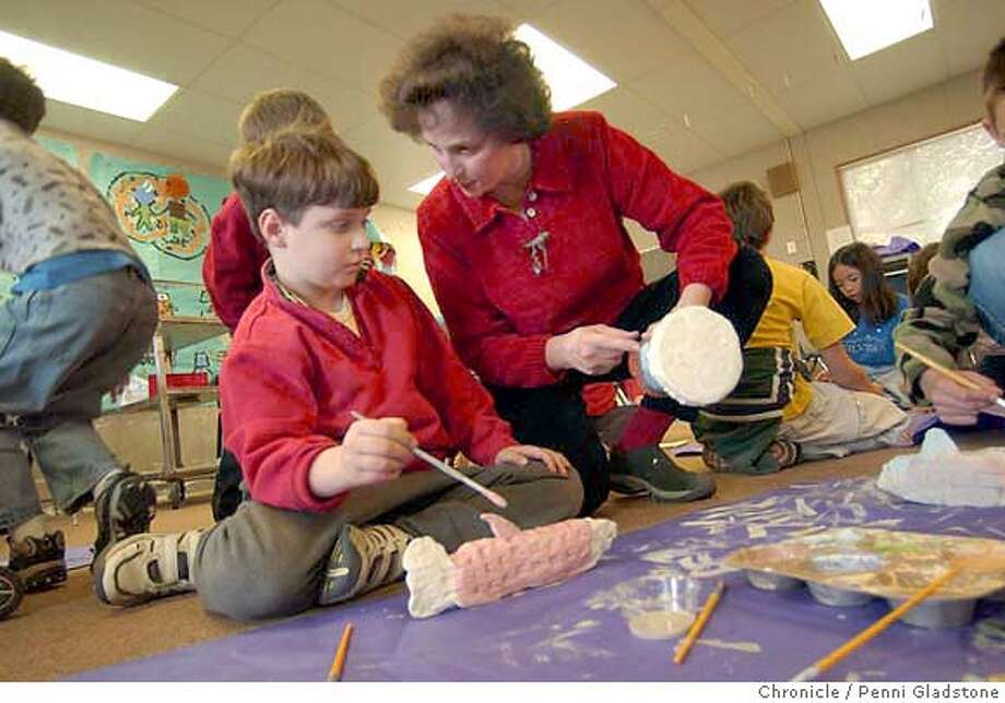 Alec Beaubois age 7yrs. is assisted by artist Linda Weill.  YOUTH IN ARTS PROGRAM. artist works with the students at Mary E. Silveira School. 2/12/04 in Novato.  PENNI GLADSTONE / The Chronicle Photo: PENNI GLADSTONE