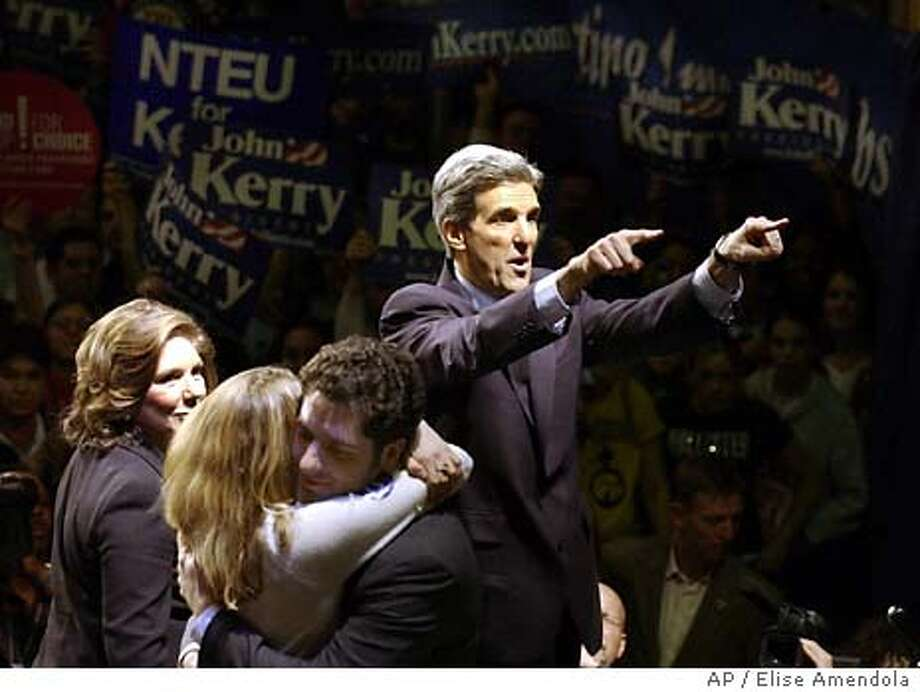 Democratic presidential hopeful Sen. John Kerry, D-Mass., points to supporters with his wife, Teresa Heinz Kerry, left, while his daughter, Vanessa, hugs his stepson, Christopher, in Washington, D.C. during his Super Tuesday Primary Night rally, Tuesday, March 2, 2004. (AP Photo/Elise Amendola) Photo: ELISE AMENDOLA