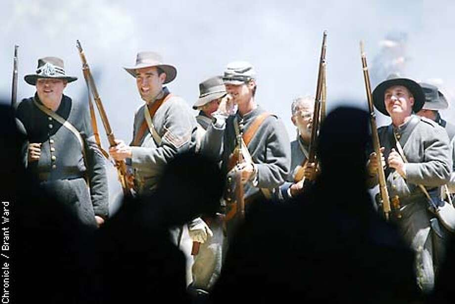 Civil War reenactments are rarely scripted affairs...in this battle held at Duncans Mill in Sonoma County, the Confederate troops took delight in running the Union troops back into the shadows and ultimately to a victory. By Brant Ward/Chronicle Photo: BRANT WARD