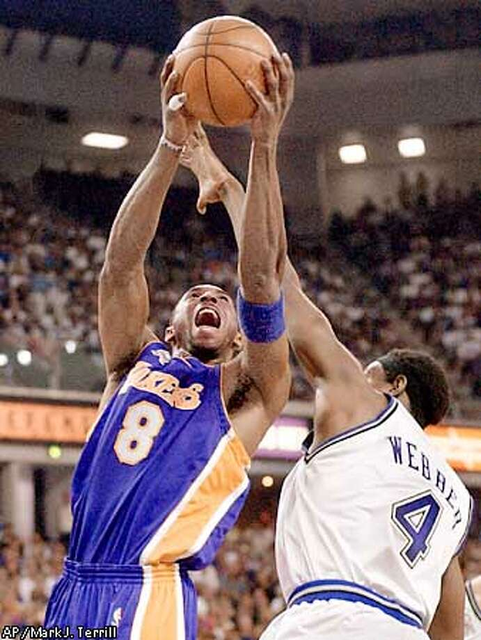 Los Angeles Lakers' Kobe Bryant shoots over the defense of Sacramento Kings' Chris Webber during the first quarter in Game 7 of the Western Conference finals in Sacramento, Calif., Sunday, June 2, 2002. (AP Photo/Mark J. Terrill) Photo: MARK J. TERRILL