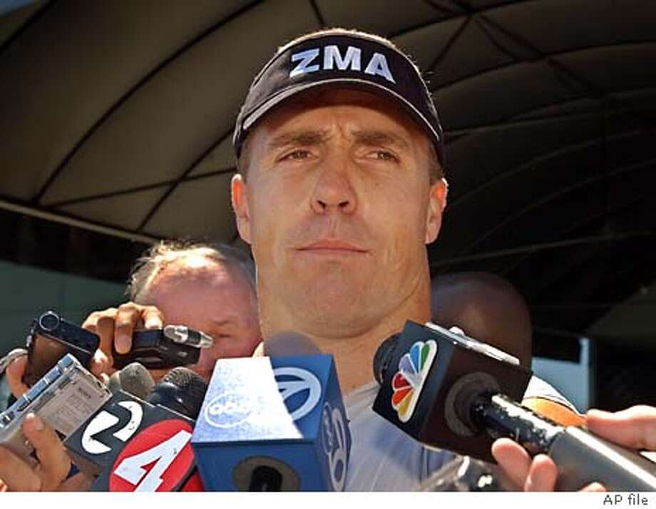 Oakland Raiders linebacker Bill Romanowski talks to reporters after practice at Raiders headquarters in Alameda, Calif., Tuesday, Aug. 26, 2003. Romanowski was suspended from Monday's practice and fined after punching and seriously injuring teammate Marcus Williams during a fight during practice on Sunday. (AP Photo/Paul Sakuma) Victor Conte is a former bassist for Tower of Power who turned into a nutritional guru. Victor Conte is a former bassist for Tower of Power who turned into a nutritional guru. Victor Conte is a former bassist for Tower of Power who turned into a nutritional guru. Chris Cooper said after yesterday's game that reporters were &quo;putting a damper on my night.&quo; Chris Cooper said after yesterday's game that reporters were &quo;putting a damper on my night.&quo; Barry Bonds Barry Bonds Bill Romanowski Barry Bonds lifts weights in 2002 while his trainer, Greg Anderson, watches. Photo: PAUL SAKUMA