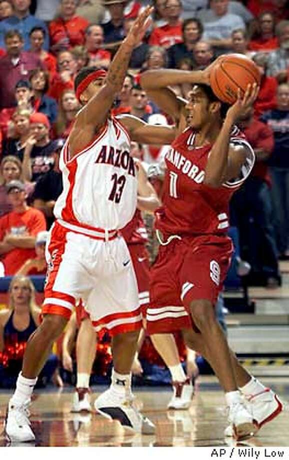 Stanford's Josh Childress (1) look to pass the ball against Arizona's Chris Rodgers (13) during the second half at McKale Center in Tucson, Ariz., on Saturday, Jan. 10, 2004. Stanford won, 82-72. (AP Photo/Wily Low) Photo: WILY LOW