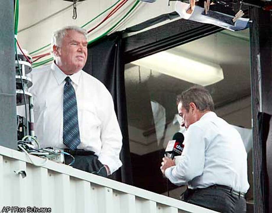 John Madden, left, looks out of the booth as partner Al Michaels does a pre-game report before the Hall of Fame game Monday, Aug. 5, 2002, in Canton, Ohio. (AP Photo/Ron Schwane) Photo: RON SCHWANE