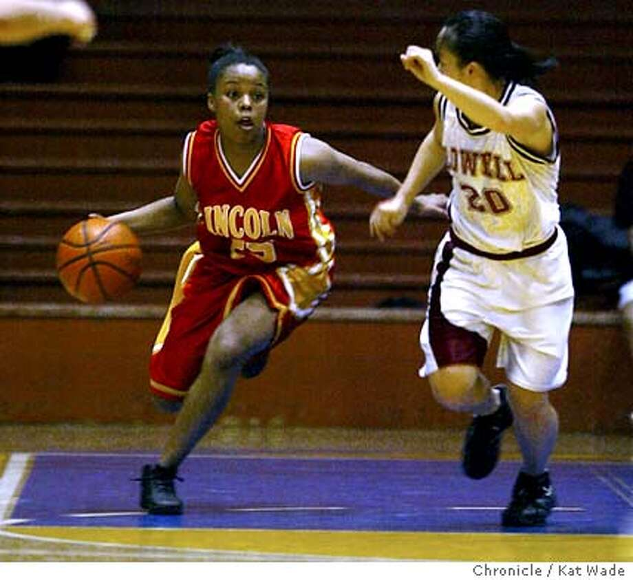 PREPGIRLS03_512_KW.jpg  (L TO R) Lincoln's Markeisha Law drives towards the basket with pressure from Lowell's Stacey Lee at the San Francisco Section Girls Varsity Playoffs at Kezar Pavillion in San Francisco on 3/2/04. The final score was Lowell 76 to Lincoln 87  Kat Wade/The Chronicle Photo: Kat Wade