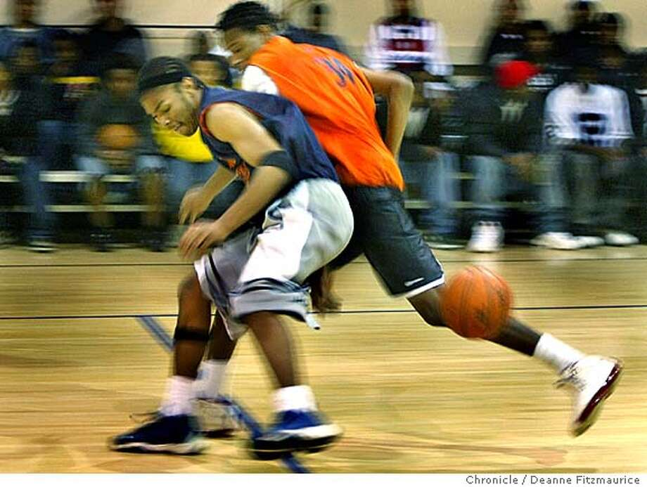 David White Jr. (left) loses the ball with Omar harris defending. Twilite basketball through the Young Adult Project at Dr. Martin Luther King, Jr Youth Services Center in Berkeley is a program aimed at helping to keep at-risk youth off the streets. Deanne Fitzmaurice / The Chronicle Photo: Deanne Fitzmaurice