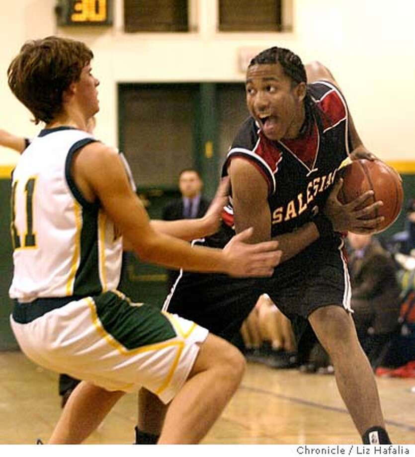 Salesian High School playing San Marin High School of Novato.  Salesian's Kendell McCree tries passing the ball during the 2nd period. Alex Kovaleff at left. Shot on 1/2/04 in Novato. LIZ HAFALIA / The Chronicle Photo: LIZ HAFALIA