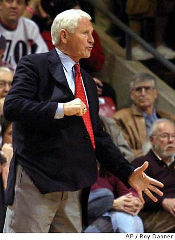 Arizona head coach Lute Olson tries to get the attention of an official, during the second half of their game against Arizona State, Saturday, Jan. 3, 2004, in Tempe, Ariz. Olson collected his 700th win as Arizona won, 93-74. (AP Photo/Roy Dabner) Photo: ROY DABNER