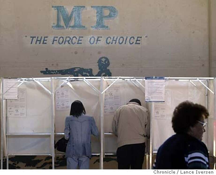 POLLPLACE104_LI.JPG event on 3/2/04 in PITTSBURGH Fewer than 6 million voters, a record low for a California presidential primary, are expected to make it to the polls. One of the more interesting polling places was Pittsburgh's National Guard Armory home for the 49th Military Police Battalion. By Lance Iversen/The San Francisco Chronicle Photo: Lance Iversen
