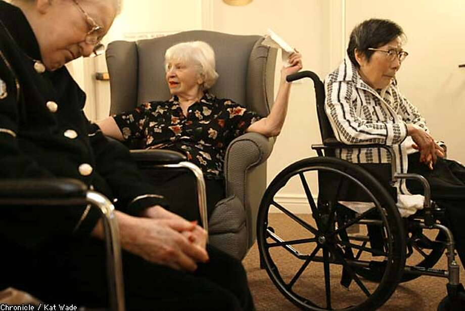 Early risers: Rosalie D'Amico, center, is up at 5:30 a.m. along with Evelyn Friedenthal, left, and Mary Louie, fellow residents of Coventry Park's Alzheimer's unit. Chronicle photo by Kat Wade
