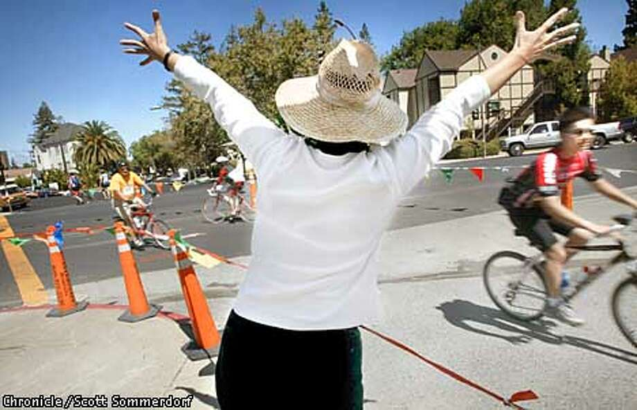 Alexia Berchem enthusiastically welcomes other riders to the finish line as she waits for her friends to finish the ride. (SF CHRONICLE PHOTO BY SCOTT SOMMERDORF) Photo: SCOTT SOMMERDORF