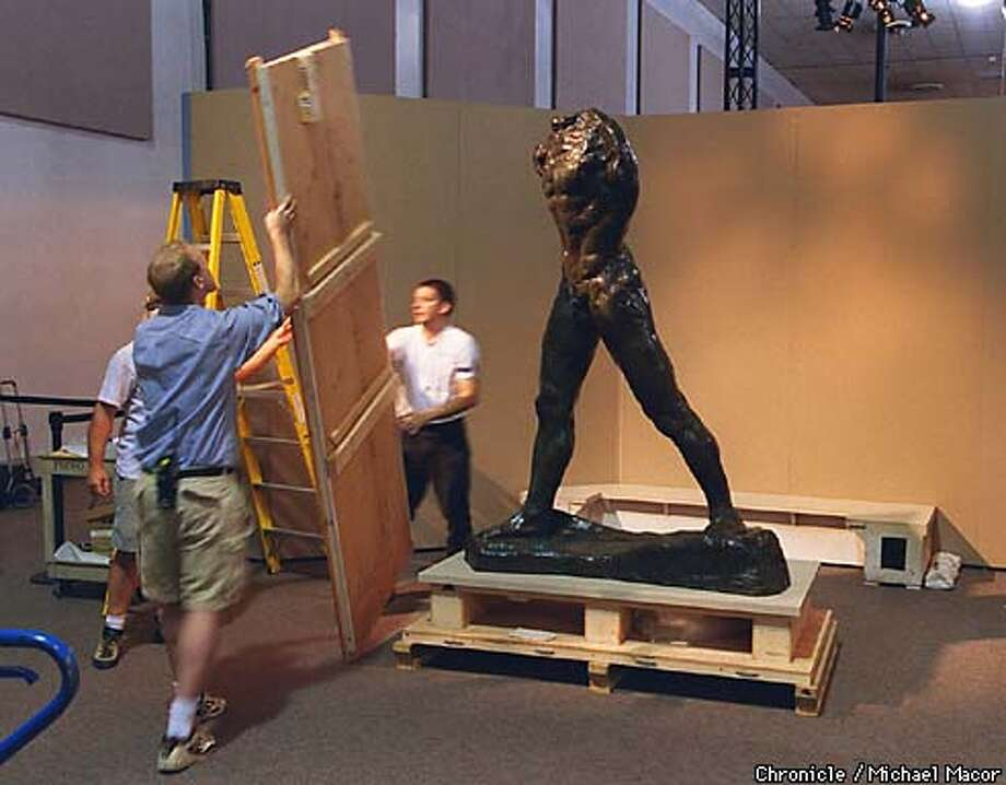 "The travel show"" America's Smithsonian"" makes a stop in San Jose. Workers unbox a sculpture by Auguste Rodin ""Walking Man"" Chronicle Photo: Michael Macor Photo: MICHAEL MACOR"