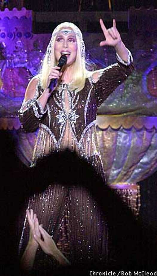 Cher, in a blond wig and lots of fringe, showed off her fabulous costumes at her Farewell Tour performance Saturday in Oakland. Chronicle photo by Bob McLeod