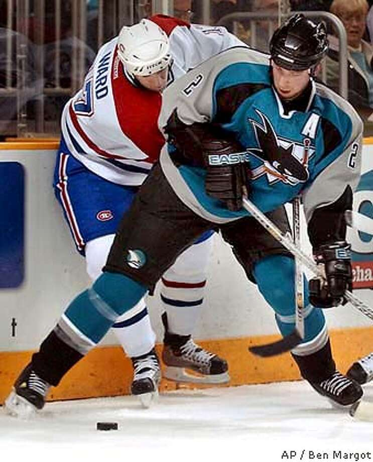 San Jose Sharks' Mike Rathje (2) and Montreal Canadiens' Jason Ward battle for possession of the puck during the first period Wednesday, March 3, 2003, in San Jose, Calif. (AP Photo/Ben Margot) Photo: BEN MARGOT