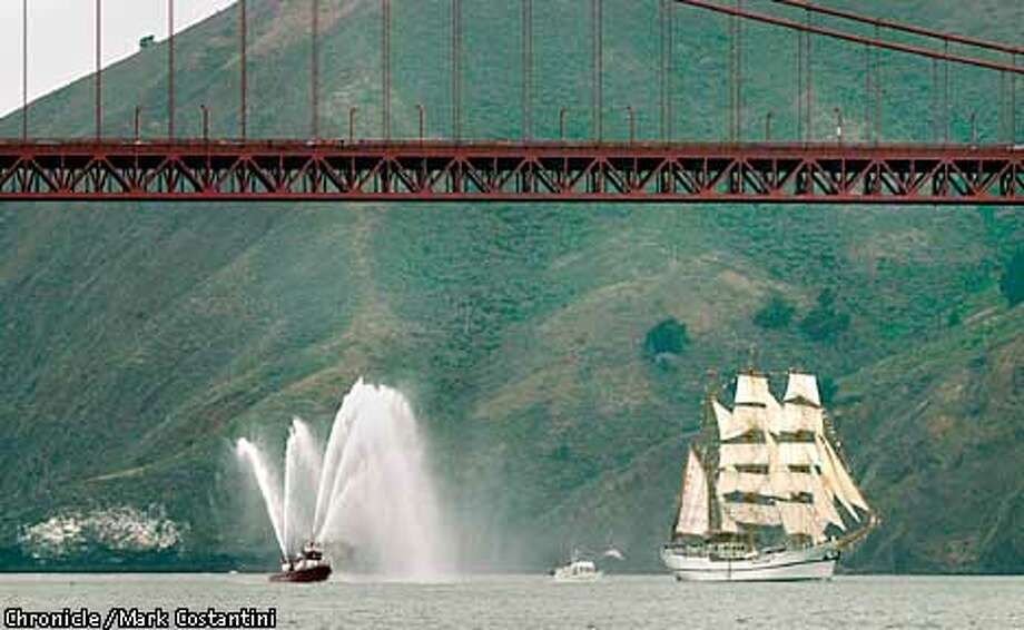 A BIG BOAT, PART OF A BIG BOAT GATHERING, SAILS UNDER THE GOLDEN GATE BRIDGE . THIS WAS THE FIRST BOAT UNDER THE BRIDGE FOR THIS YEAR'S GATHERING. Photo: Mark Costantini/SF Chronicle Photo: MARK COSTANTINI