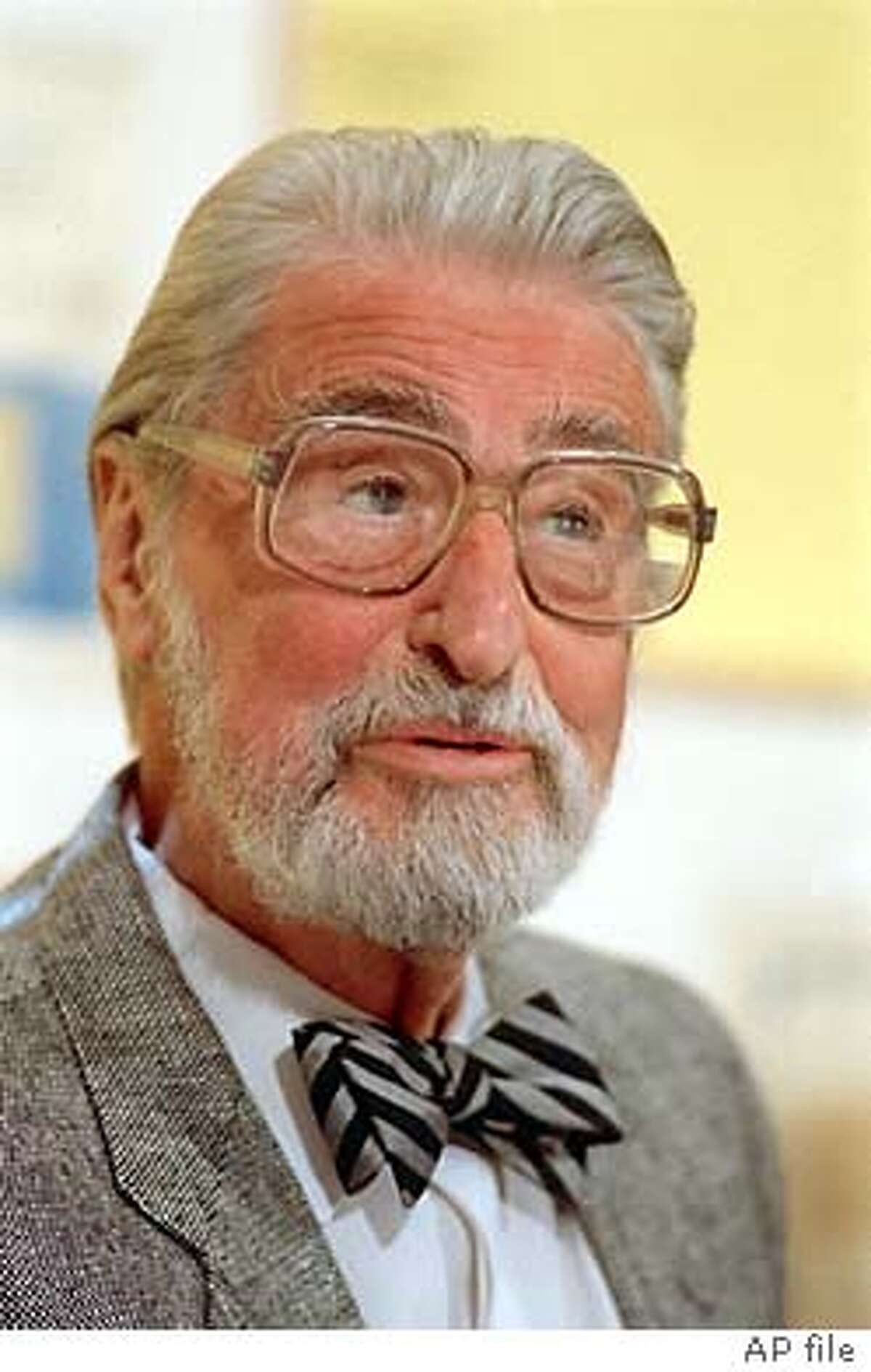 ** ADVANCE FOR WEEKEND, FEB. 26-29 **FILE**The late American author, artist and publisher Theodor Geisel, known by his pen name Dr. Seuss, speaks in Dallas, Texas, on April 3, 1987. The 100th anniversary of Geisel's birth is March 2, 2004, nearly 13 years after his death. (AP Photo) Theodor Geisel with two taxidermy creations, Sea Turtle and The Goo Goo Eyed Tasmanian Wolghast.
