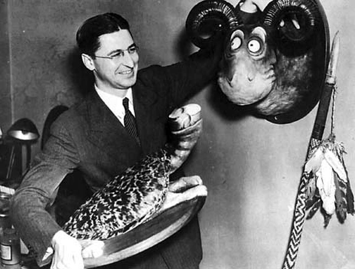 Ted Geisel with two taxidermy creations, SEA TURTLE and THE GOO GOO EYED TASMANIAN WOLGHAST.