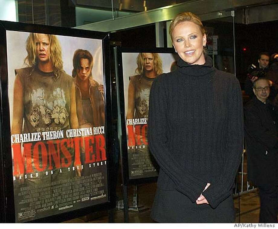 "Actress Charlize Theron, who stars in the movie ""Monster,"" arrives at the premiere of the film Wednesday, Dec. 17, 2003, in New York. The movie is about Aileen Carol Wuornos, a highway prostitute who was executed for killing seven men in Florida in the 1980's. (AP Photo/Kathy Willens) STAND ALONE PHOTO Photo: KATHY WILLENS"