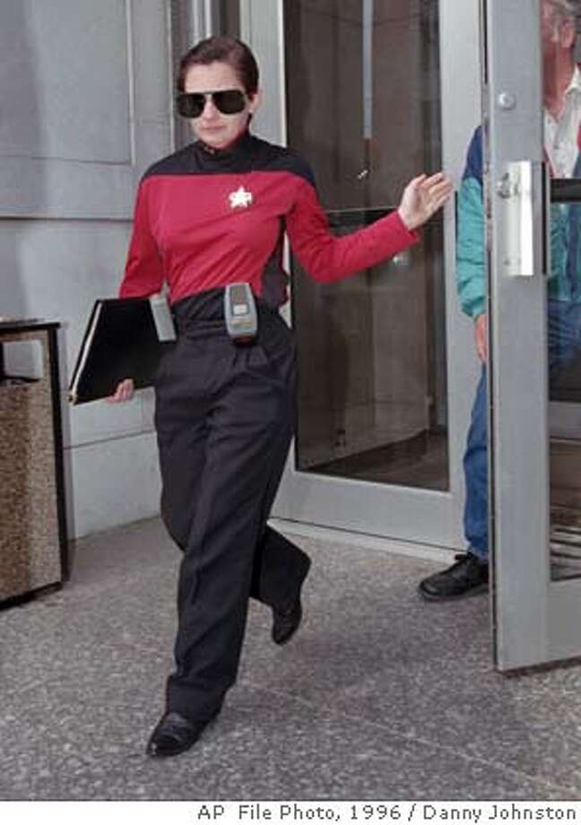 """Prospective Whitewater juror Barbara Adams of Little Rock, Ark., leaves the Little Rock federal courthouse Tuesday, March 5, 1996, with others during a break. Adams said she always wears her """"Star Trek"""" uniform at formal occasions. (AP Photo/Danny Johnston) CAT Photo: DANNY JOHNSTON"""