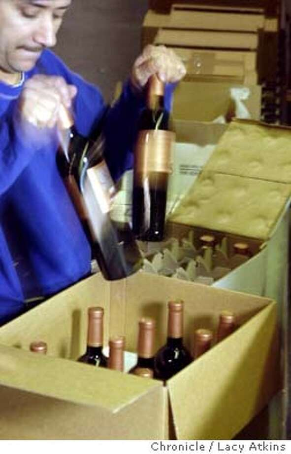CLUBS_011_.jpg  Ivan Cano packages bottles of wine for a wine club member shipment at the Aero Packing Company, Monday Jan.5, 2004, in American Canyon. AERO Packing Company assembles wine club shipments, Monday Jan. 5, 2004, in American Canyon.  Lacy Atkins / The Chronicle ProductNameChronicle Ivan Cano of Aero Packing in American Canyon readies a shipment for wine club members wanting something special. Photo: Lacy Atkins