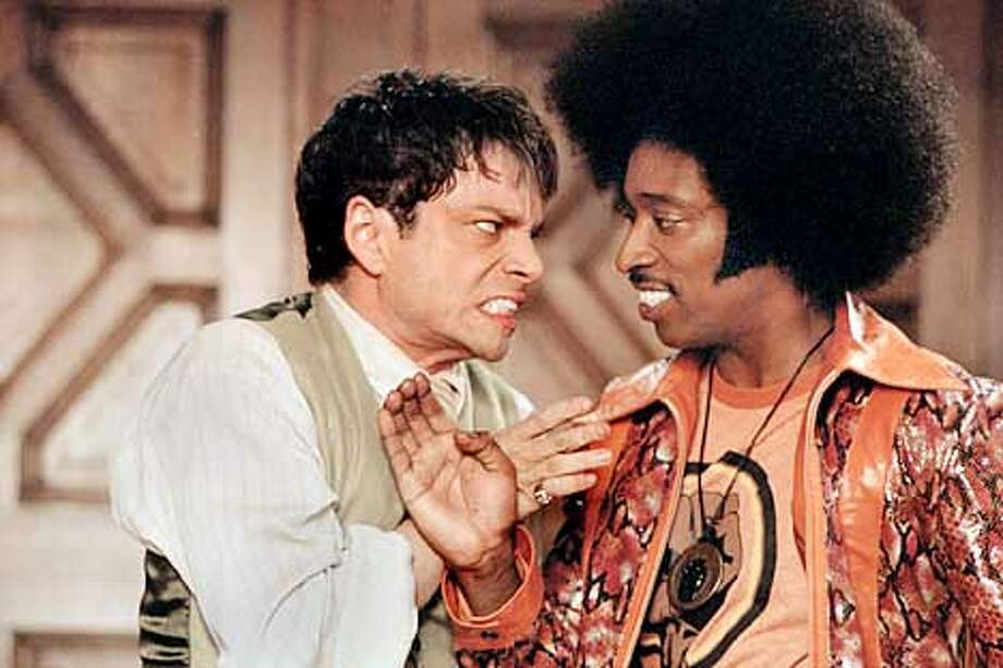 Chris Kattan (l) and Eddie Griffin in UNDERCOVER BROTHER.  (HANDOUT PHOTO) Photo: HANDOUT