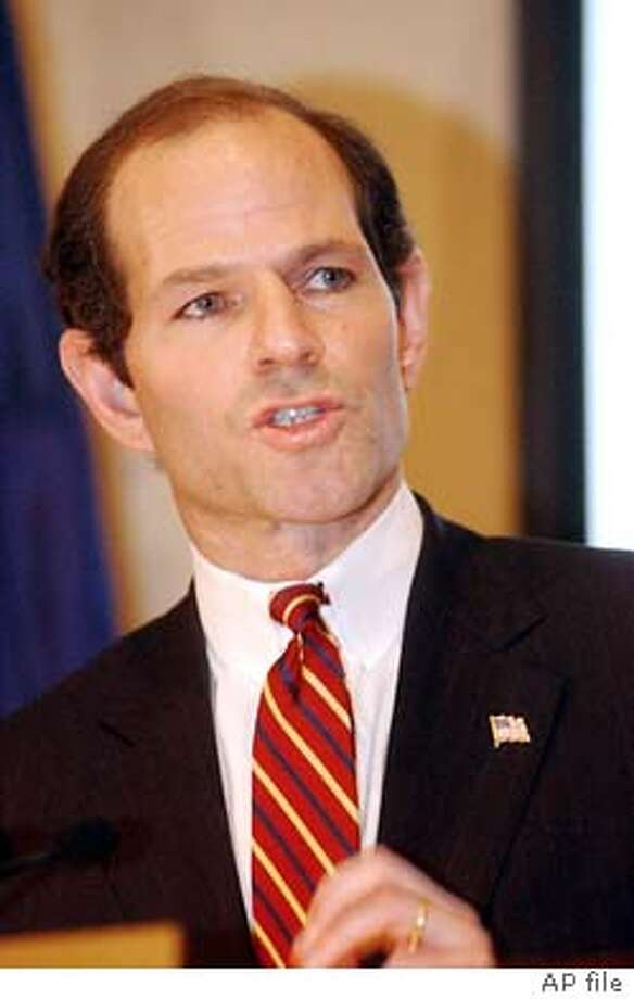 New York Attorney Genteral Eliot Spitzer answers questions during a news conference Friday, Dec. 20, 2002 in New York. The press conference was held to discuss the settlement under which top brokerages agreed to pay $1.43 billion to resolve conflict-of-interest allegations. (AP Photo/Frank Franklin II)  ALSO RAN 02/21/03 TPheodtore Siphpol III caption D faces felony charges of helping a hedge fund engage in late trading. ummy text goes here. Photo: FRANK FRANKLIN II