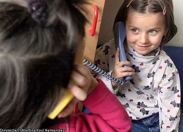 CHRISTINA KOCI HERNANDEZ/CHRONICLE  Melisa Muhic, age 4, from Bosnia, plays phone with a friend while her mom attends a family literacy program in Oakland's San Antonio neighborhood. Oakland's San Antonio district. Photo: CHRISTINA KOCI HERNANDEZ