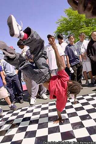 CHRISTINA KOCI HERNANDEZ/CHRONICLE  Break dancers show their stuff at a Malcom X celebration at San Antonio park.Oakland's San Antonio neighborhood. Photo: CHRISTINA KOCI HERNANDEZ