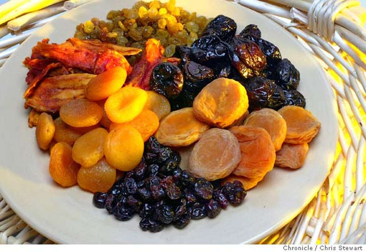Event on 12/30/03 in San Francisco. Dried fruit in a bowl. Styling by Noel Advincula. Chris Stewart / The Chronicle