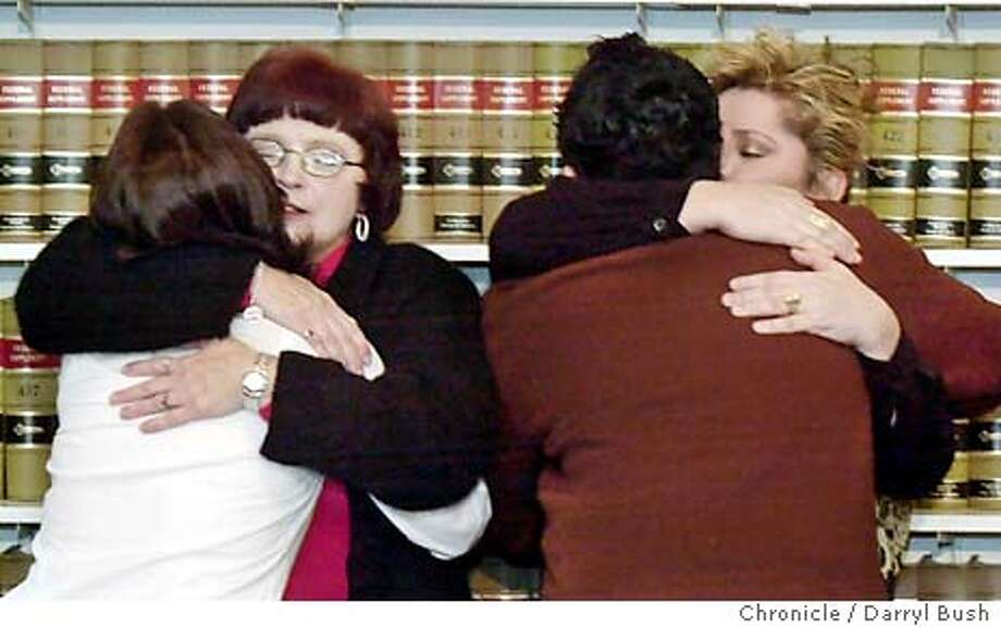 Lead plaintiff, Alana Flores, 24, of Los Banos, CA, (back turned) hugs her mother, Deborah Flores, left, along with fellow plaintiff, Freddie Fuentes, 24, (back turned) of Morgan Hill, CA, also hugging his mother, Maritza Glynn of Morgan Hill, after they announced at a ACLU press conference in San Francisco, they have settled a harassment lawsuit brought by six former students against the Morgan Hill Unified School District. Lead plaintiff and former student, Alana Flores of Los Banos, talks about suffering anti-gay abuse at school, as well as former student, Freddie Flores of Morgan Hill. 1/6/04 in San Francisco. DARRYL BUSH / The Chronicle Photo: DARRYL BUSH