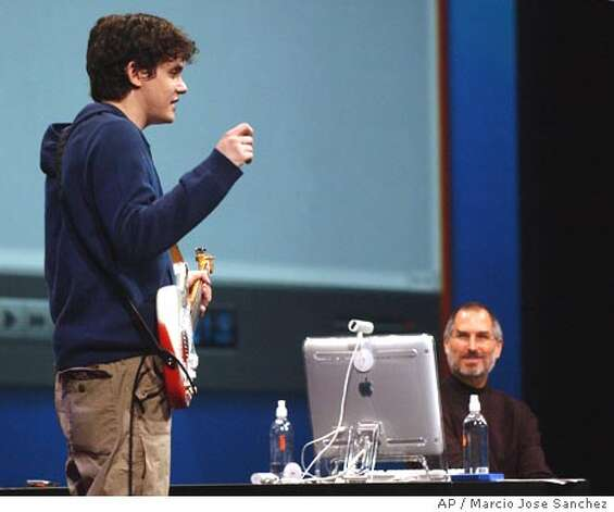 Musician John Mayer, left, demonstrates the new software music composing software Garage Band along with Apple CEO Steve Jobs, right, at the Macworld Conference and Expo in San Francisco on Tuesday, Jan 6, 2004. (AP Photo/Marcio Jose Sanchez) Photo: MARCIO JOSE SANCHEZ