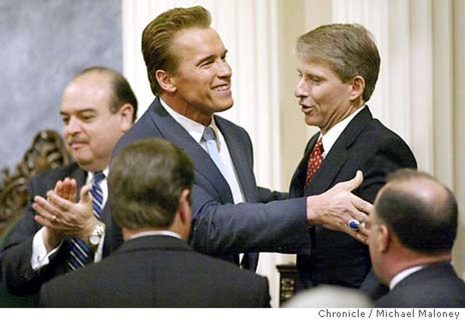Gov. Arnold Schwarzenegger shakes hands after his speech. At left is Lt Gov Cruz Bustamante. At right is California State Controller Steve Westley.  Gov. Arnold Schwarzenegger gave his first State of the State address Tuesday evening in the Assembly Chambers of the State Capitol in Sacramento. Michael Maloney / The Chronicle Photo: Michael Maloney