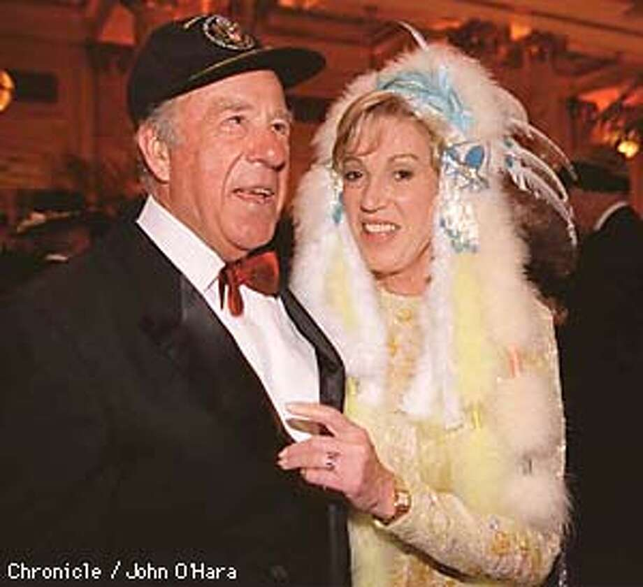 George Shultz (in a cap that reads `Secretary of State') and Charlotte Swig at `An Affair of State' at the Palace.