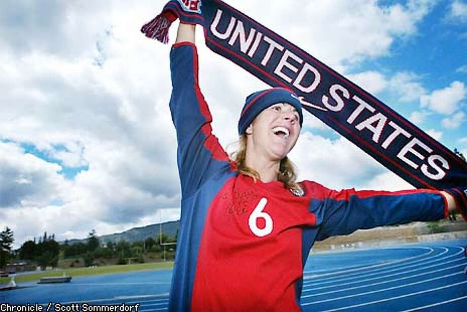 Brandi Chastain is a big fan of World Cup soccer and is looking forward to rooting for the USA. She has a jersey (signed by Pele') and hat and a soccer scarf ready for her role as a fan. (SF CHRONICLE PHOTO BY SCOTT SOMMERDORF) Photo: SCOTT SOMMERDORF