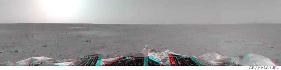 """This panoramic view of the landscape of Mars is the first three dimensional stereo image from the rover's navigation camera. The 3-D photo is a combination of the rover's right and left camera. A surface depression that scientists have nicknamed """"Sleepy Hollow"""" can be seen to center left of the image. NASA/JPL image via Associated Press"""