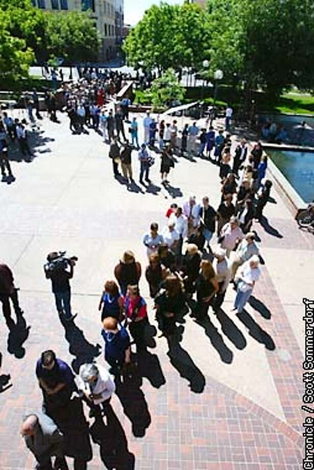 A line forms outside the Centre Plaza building where the memorial service was held.  A public memorial service was held for Chandra Levy this morning in Modesto.  CHRONICLE PHOTO BY SCOTT SOMMERDORF Photo: SCOTT SOMMERDORF
