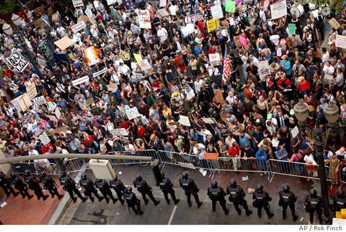 Protesters fill a street in downtown Portland, Ore., Thursday, Aug. 22, 2002, demonstrating against President Bush who was appearing at a nearby hotel. Riot police fired pepper spray at hundreds of protesters and struck some with batons on Thursday after ordering them to move from an area near a hotel where Bush was holding a fund-raiser. (AP Photo/The Oregonian, Rob Finch) CAT MAGS OUT Insight#Insight#Chronicle#01/04/04#ALL#Advance##