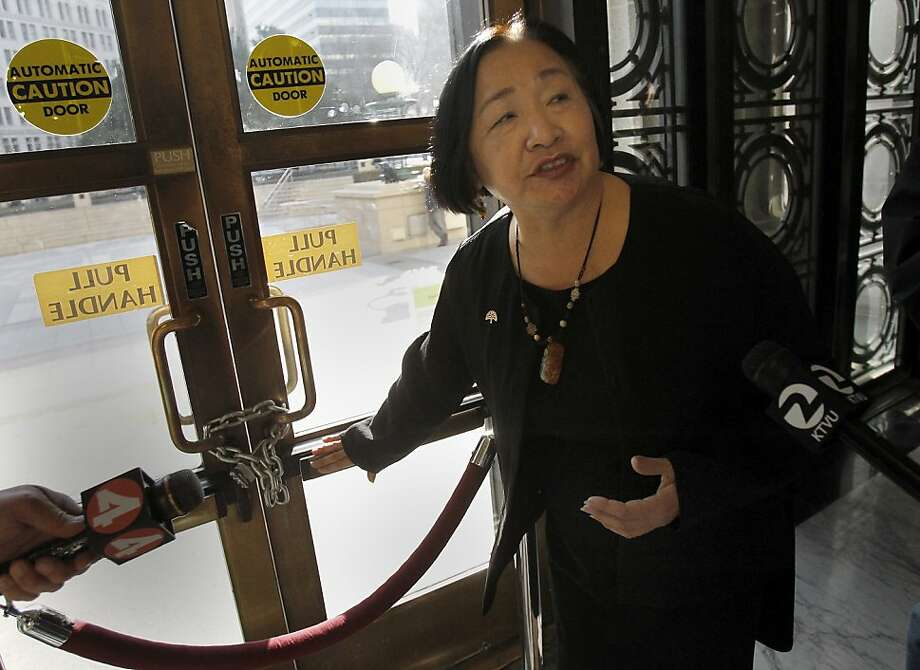 Mayor Jean Quan showed the steel chain holding the doors to City Hall closed after a protester managed to use a crow bar to gain entry Saturday night. Oakland, Calif. Mayor Jean Quan led a tour of the damage done inside Oakland City Hall Sunday January 29, 2012 by occupy protesters Saturday night. Photo: Brant Ward, The Chronicle