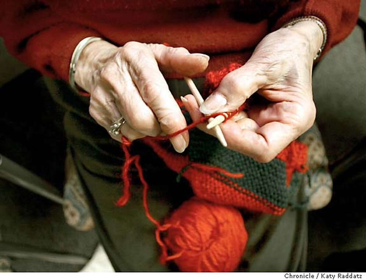 KNITTERS116_rad.jpg Many people meet each Thursday at California Pacific Medical Center to knit blankets for babies in the hospital's neo-natal unit and pediatric patients. SHOWN: The hands of Edythe (cq) Newman working on a red-and-green diagonal stripe blanket. KATY RADDATZ / The Chronicle