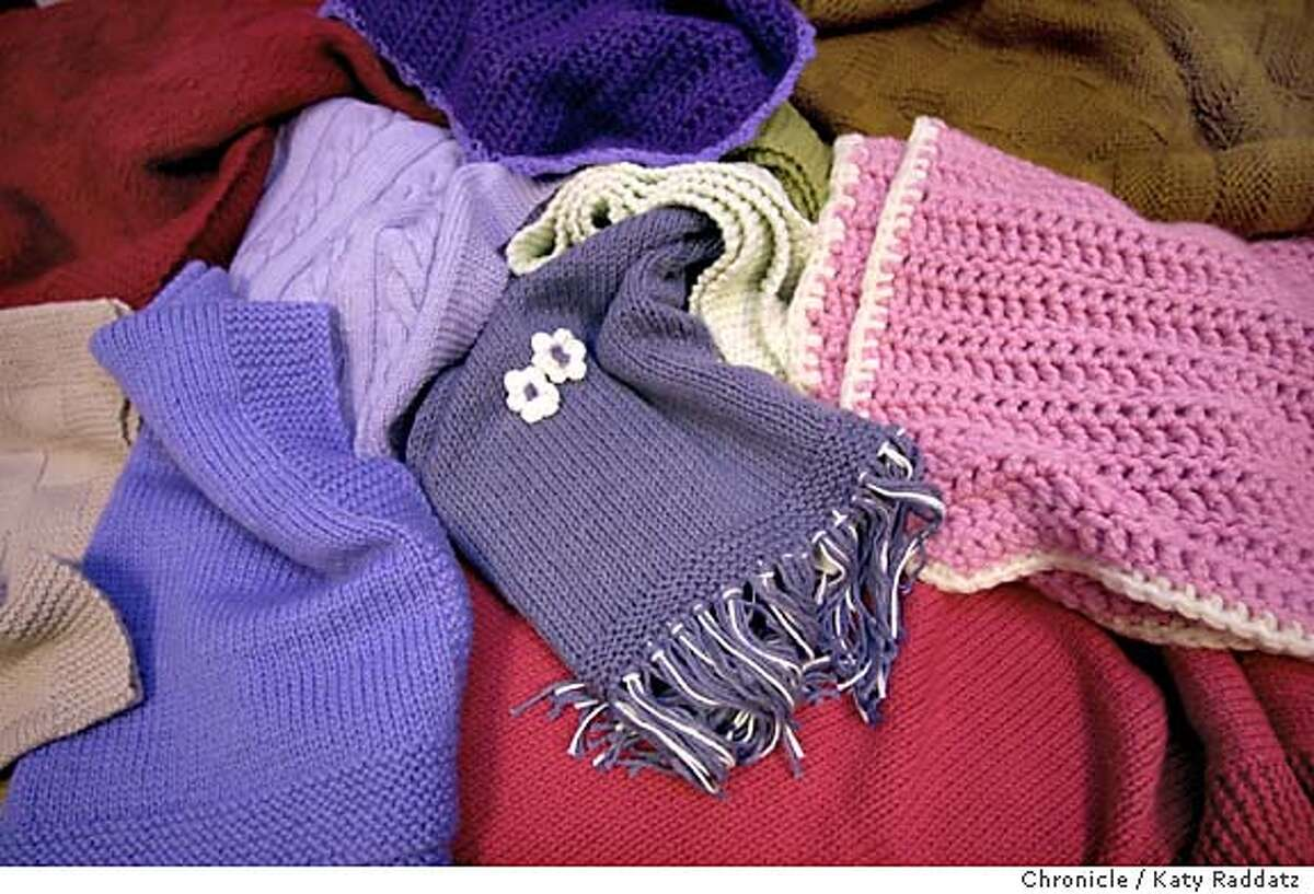 KNITTERS010_rad.jpg Many people meet each Thursday at California Pacific Medical Center to knit blankets for babies in the hospital's neo-natal unit and pediatric patients. SHOWN: a medley of blankets await distributions to tiny patients. KATY RADDATZ / The Chronicle