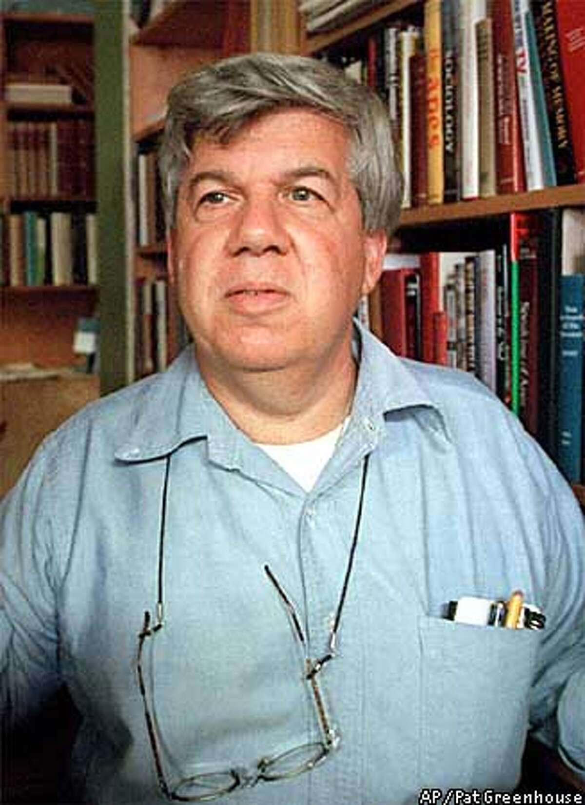 ** FILE ** Famed Harvard University biologist and author Stephen J. Gould, is shown at his Cambridge, Mass., office, in this 1997 file photo. Gould, 60, died Monday, May 20, 2002, of cancer at his home in New York. (AP Photo/The Boston Globe, Pat Greenhouse)