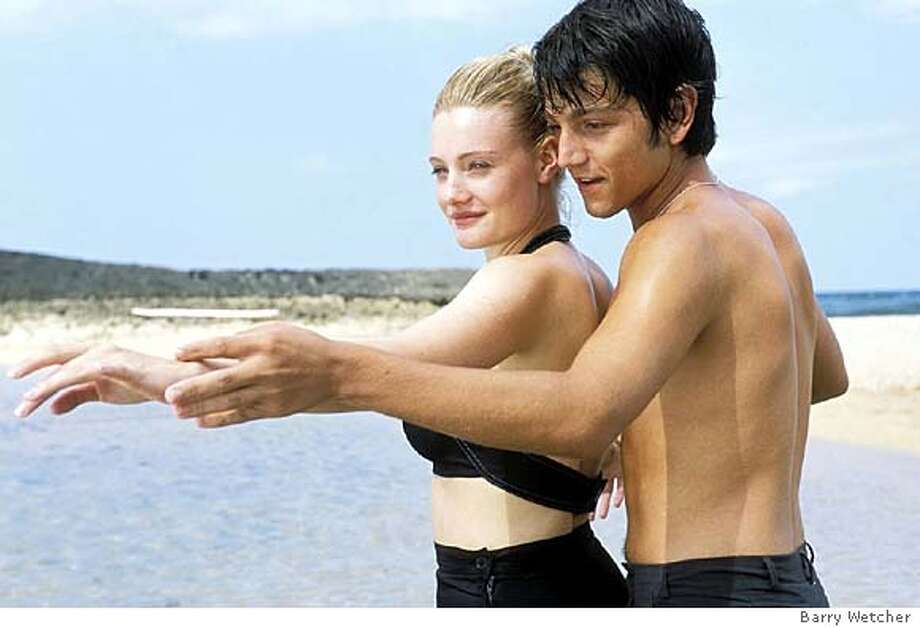"Katey (Romola Garai) and Javier (Diego Luna) practice their moves on the beach in ""Dirty Dancing: Havana Nights."" (AP Photo/ Barry Wetcher) Katey (Romola Garai) and Javier (Diego Luna) practice moves in &quo;Dirty Dancing: Havana Nights.&quo; Photo: BARRY WETCHER"