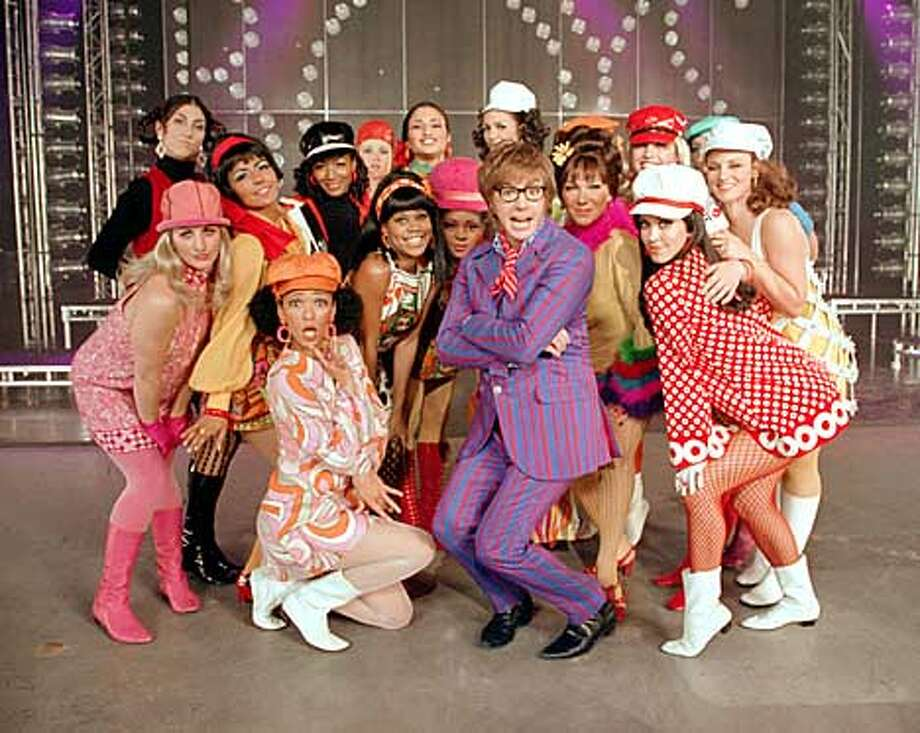 "CN-77-35F Austin Powers (Mike Myers) has a way with the ladies in New Line Cinema's comedy ""Austin Powers(tm) in Goldmember"".Photo: Melinda Sue Gordon/SMPSP/New Line Productions  (HANDOUT PHOTO) Photo: HANDOUT"