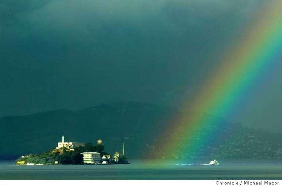 rainbow031.mac.jpg A rainbow, seen from Treasure Island, inches towards Alcatraz Island Friday morning as a new set of rain storms head for the Bay Area. Chronicle Photo/ Michael Macor Photo: Michael Macor