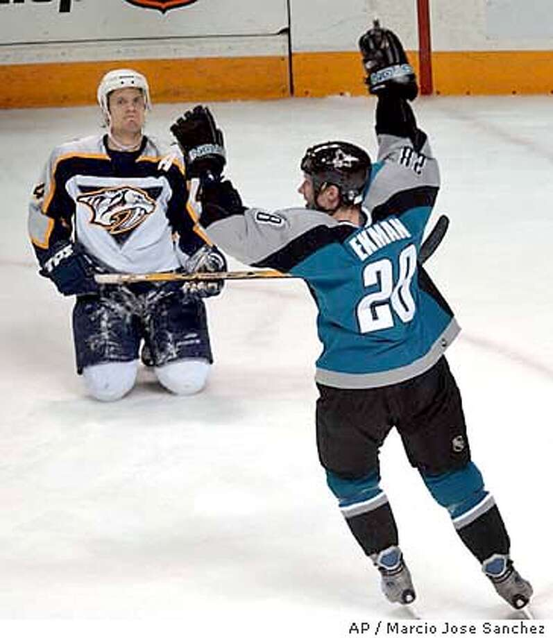 San Jose Sharks' Nils Ekman, of Sweden, right, celebrates after scoring a goal as Nashville Predators' Mark Eaton, left, kneels on the ice in the third period in San Jose, Calif., Monday, Dec. 29, 2003. San Jose won 5-2. (AP Photo/Marcio Jose Sanchez) Photo: MARCIO JOSE SANCHEZ