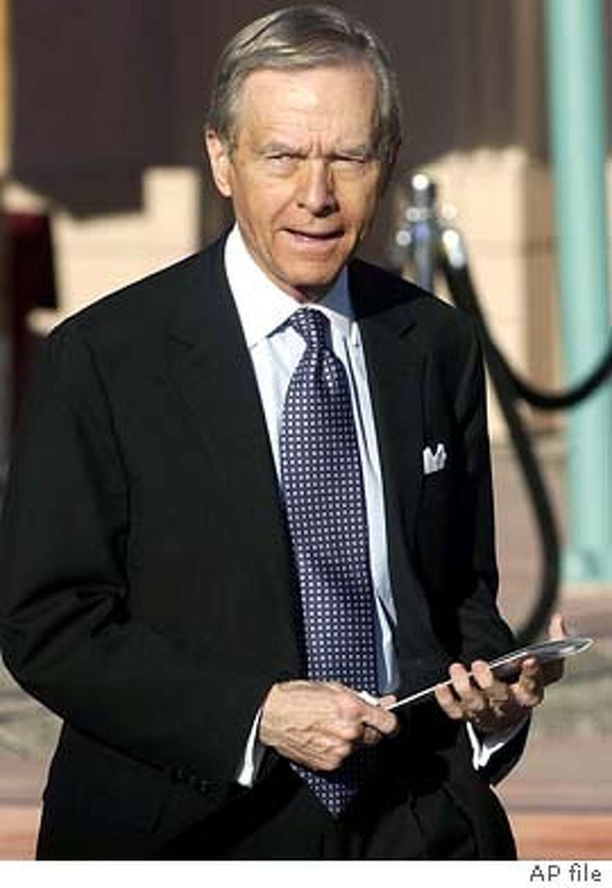 """Former California Governor Pete Wilson leaves """"The Bob Hope Memorial Tribute"""" at the Academy of Television Arts and Sciences Wednesday, Aug. 27, 2003 in the North Hollywood section of Los Angeles. (AP Photo/Matt Sayles)"""